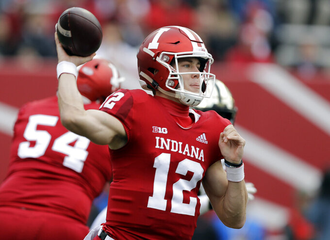 FILE - In this Nov. 24, 2018, file photo, Indiana quarterback Peyton Ramsey throws during the first half of an NCAA college football game against Purdue in Bloomington, Ind. Seven of the 14 Big Ten teams are coming out of spring practices planning to continue quarterback auditions in August. Indiana's Peyton Ramsey is competing against redshirt freshmen Michael Penix Jr(AP Photo/Darron Cummings)