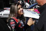 FILE - In this Oct. 18, 2019, file photo, driver Hailie Deegan talks to her crew chief after practicing foran ARCA Series auto race at Kansas Speedway in Kansas City, Kan. Deegan has moved from Toyota to Ford in a driver development deal announced Tuesday, Dec. 17, 2019. Ford will work to fast-track the rising star into one of NASCAR's national series over the next few seasons. (AP Photo/Colin E. Braley, File)