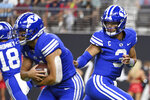 BYU quarterback Jaren Hall (3) hands off to running back Lopini Katoa during the first half of the team's NCAA college football game against Arizona on Saturday, Sept. 4, 2021, in Las Vegas. (AP Photo/David Becker)