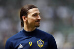 FILE - In this March 31, 2018, file photo, Los Angeles Galaxy's Zlatan Ibrahimovic, of Sweden, stands on the field during warmups before an MLS soccer match against the Los Angeles FC in Carson, Calif. (AP Photo/Jae C. Hong, File)