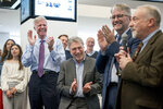 From left, Washington Post Publisher Fred Ryan, Executive Editor Marty Baron, and National Security Editor Peter Finn, applaud as investigative reporter Tom Hamburger speaks to the newsroom after The Washington Post wins two pulitzer prizes, Monday, April 16, 2018, in Washington. The Post shared a Pulitzer with the New York Times for their coverage of Russian meddling in the 2016 U.S. presidential election and contacts between President Donald Trump's campaign and Russian officials, and won a second Pulitzer for uncovering the decades-old allegations of sexual misconduct against Senate candidate Roy Moore of Alabama. (AP Photo/Andrew Harnik)