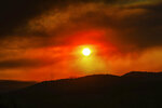 The sun sets with smoke in the sky from the Grizzly Creek Fire Thursday, Aug. 13, in Eagle, Colo.  Wildfires burning in western Colorado continue to grow in warm, windy weather, fueled by drought conditions.(Chris Dillmann/Vail Daily via AP)