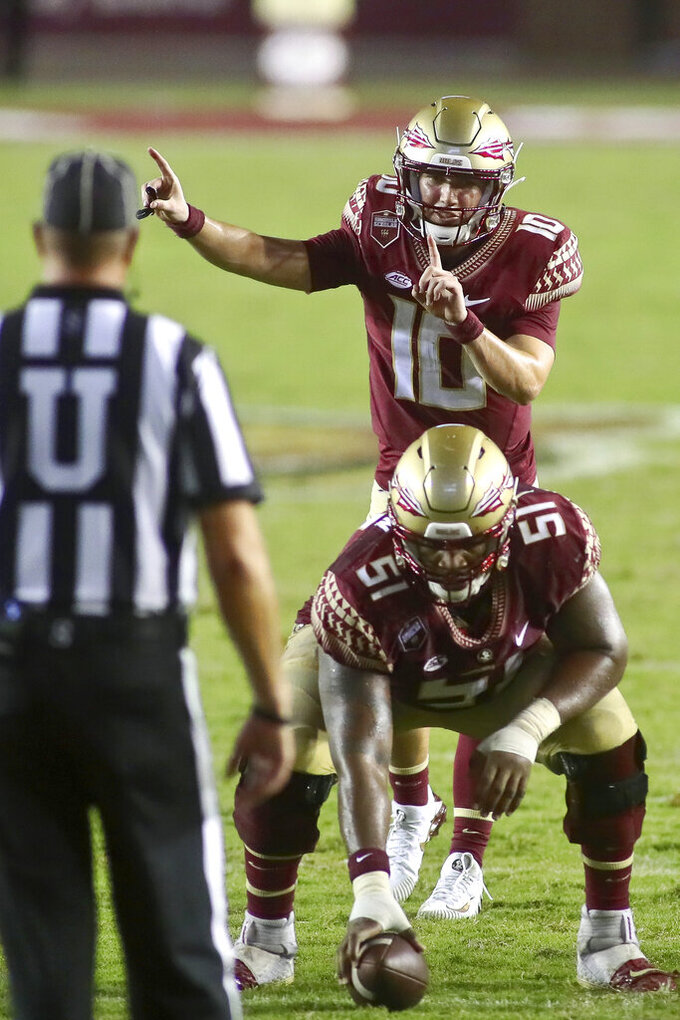 Florida State quarterback McKenzie Milton (10) signals to his team in overtime of an NCAA college football game against Notre Dame Sunday, Sept. 5, 2021, in Tallahassee, Fla. Notre Dame won 41-38. (AP Photo/Phil Sears)