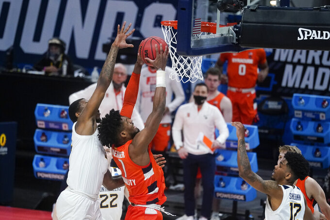 Syracuse's Quincy Guerrier (1) goes up for a dunk against West Virginia's Gabe Osabuohien (3) during the second half of a second-round game in the NCAA men's college basketball tournament at Bankers Life Fieldhouse, Sunday, March 21, 2021, in Indianapolis. Syracuse defeated Syracuse 75-72. (AP Photo/Darron Cummings)