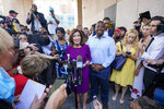 New York Gov. Kathy Hochul, center, joined by New York State Sen. Brian Benjamin, right, speaks to reporters after an event in the Harlem neighborhood of New York, Thursday, Aug. 26, 2021, in New York. Hochul selected Benjamin as her choice for lieutenant governor. (AP Photo/Mary Altaffer)