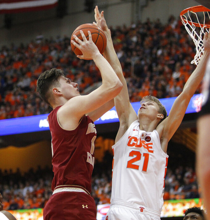 Boston College's Luka Kraljevic, left, shoots against Syracuse's Marek Dolezaj, right, during the second half of an NCAA college basketball game in Syracuse, N.Y., Saturday, Feb. 9, 2019. Syracuse won 67-56. (AP Photo/Nick Lisi)