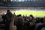 England supporters celebrate their team second goal during the Euro 2020 soccer championship semifinal match between England and Denmark at Wembley stadium in London, Wednesday, July 7, 2021. (Catherine Ivill/Pool Photo via AP)