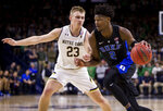 Duke's Cam Reddish (2) drives by Notre Dame's Dane Goodwin (23) during the first half of an NCAA college basketball game Monday, Jan. 28, 2019, in South Bend, Ind. (AP Photo/Robert Franklin)
