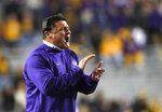 FILE- In this Nov. 17, 2018 file photo, LSU head coach Ed Orgeron calls out from the sideline in the second half of an NCAA college football game against Rice in Baton Rouge, La. No. 7 Central Florida is aiming for a second straight undefeated season and self-proclaimed national championship when they go up against No. 11 LSU in the Fiesta Bowl, Tuesday, Jan. 1, 2019. (AP Photo/Gerald Herbert, File)