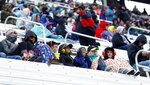Children watch during a NASCAR Cup Series auto race, Monday, April 16, 2018 in Bristol, Tenn.,  after school was closed and they were able to attend the race for free. (AP Photo/Wade Payne)
