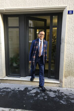 Cambodia's most prominent opposition politician Sam Rainsy, co-founder of the Cambodia National Rescue Party, leaves a house in Paris, Thursday Nov.7, 2019 before heading to Paris airport and flying to Bangkok. Sam Rainsy said Tuesday he was ready to risk imprisonment or death by returning to his country from self-imposed exile to unseat the country's longtime ruler. (AP Photo/Nicolas Garriga)