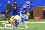 Detroit Lions running back D'Andre Swift (32) runs for a 43 touchdown reception against the San Francisco 49ers in the second half of an NFL football game in Detroit, Sunday, Sept. 12, 2021. (AP Photo/Lon Horwedel)