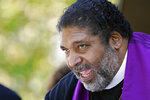 Rev. William J. Barber II, national co-chair of the Poor People's Campaign, tells a gathering in downtown Jackson, Miss., that restoring voting rights to people who have finished serving time is a moral imperative, Monday, April 19, 2021. Barber was among speakers who addressed voter suppression, restoration of voting rights to people who finished serving time, police violence, and a low minimum wage. The Campaign seeks to have the issues addressed at a national assembly later this year. (AP Photo/Rogelio V. Solis)
