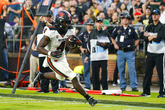 Oregon State running back B.J. Baylor (4) runs in for a touchdown against Purdue during the first half of an NCAA college football game in West Lafayette, Ind., Saturday, Sept. 4, 2021. (AP Photo/Michael Conroy)