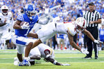 Kentucky wide receiver Wan'Dale Robinson (1) runs the ball into the end zone during the first half of an NCAA college football game against Louisiana-Monroe in Lexington, Ky., Saturday, Sept. 4, 2021. (AP Photo/Michael Clubb)