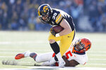 Iowa tight end Nate Wieting (39) breaks a tackle by Illinois linebacker Milo Eifler (5) after catching a pass during the first half of an NCAA college football game, Saturday, Nov. 23, 2019, in Iowa City, Iowa. (AP Photo/Charlie Neibergall)