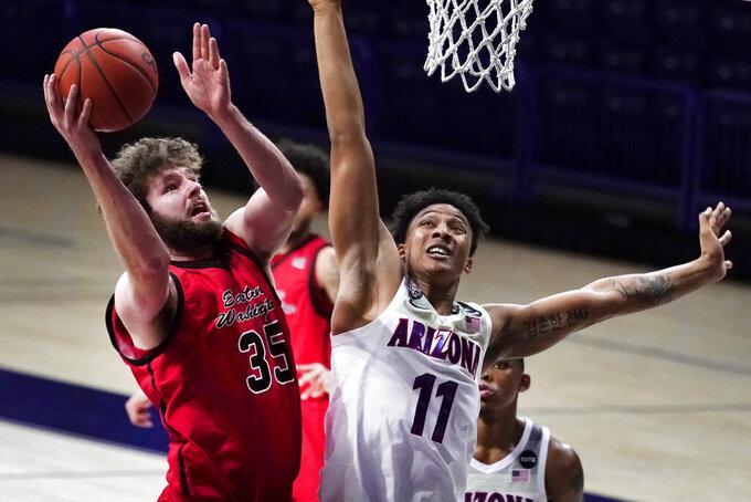 Eastern Washington forward Tanner Groves shoots over Arizona forward Ira Lee (11) during the second half of an NCAA college basketball game, Saturday, Dec. 5, 2020, in Tucson, Ariz. Arizona won 70-67. (AP Photo/Rick Scuteri)