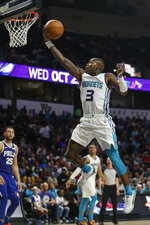 Charlotte Hornets guard Terry Rozier III, drives to the basket against the Philadelphia 76ers in the second half of a preseason NBA basketball game in Winston-Salem, N.C., Friday, Oct. 11, 2019. Philadelphia won 100-87. (AP Photo/Nell Redmond)