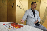 Hong Kong media tycoon Jimmy Lai gesture next to a copy of Apple Daily's July 1 edition during an interview Hong Kong Wednesday, July 1, 2020. Lai said in an interview Wednesday that Hong Kong is dead under the new national security law. Lai, who owns popular newspaper Apple Daily, is a prominent advocate for democracy in Hong Kong. (AP Photo/Vincent Yu)
