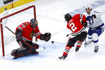 Chicago Blackhawks goaltender Corey Crawford (50) makes a save as defenseman Duncan Keith (2) keeps Tampa Bay Lightning's Erik Cernak from getting a rebound during the second period of an NHL hockey game Thursday, Nov. 21, 2019, in Chicago. (AP Photo/Charles Rex Arbogast)