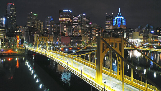 This Nov. 26, 2020 file photo shows the newly refurbished Rachel Carson Bridge over the Allegheny River in downtown Pittsburgh.  President Joe Biden wants $2 trillion to reengineer America's infrastructure and expects the nation's corporations to pay for it. The Democratic president travels to Pittsburgh on Wednesday, March 31, 2021 to unveil what would be a hard-hatted transformation of the U.S. economy.(AP Photo/Gene J. Puskar/File)