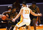 Appalachian State guard Adrian Delph (20) tries to move past Tennessee forward Uros Plavsic (33) during an NCAA college basketball game in Knoxville, Tenn., on Tuesday, Dec. 15, 2020.  (Brianna Paciorka/Knoxville News Sentinel via AP)