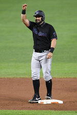 Miami Marlins' Francisco Cervelli gestures as he stands on second with a double during the third inning of a baseball game against the Baltimore Orioles, Thursday, Aug. 6, 2020, in Baltimore. (AP Photo/Nick Wass)