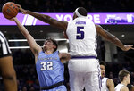 Northwestern center Dererk Pardon, right, blocks a shot by Columbia guard Maka Ellis during the first half of an NCAA college basketball game Sunday, Dec. 30, 2018, in Evanston, Ill. (AP Photo/Nam Y. Huh)