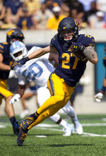 California's Ashtyn Davis (27) runs back a kickoff against North Carolina during the second half of an NCAA college football game, Saturday, Sept. 1, 2018, in Berkeley, Calif. California won 24-17. (AP Photo/D. Ross Cameron)