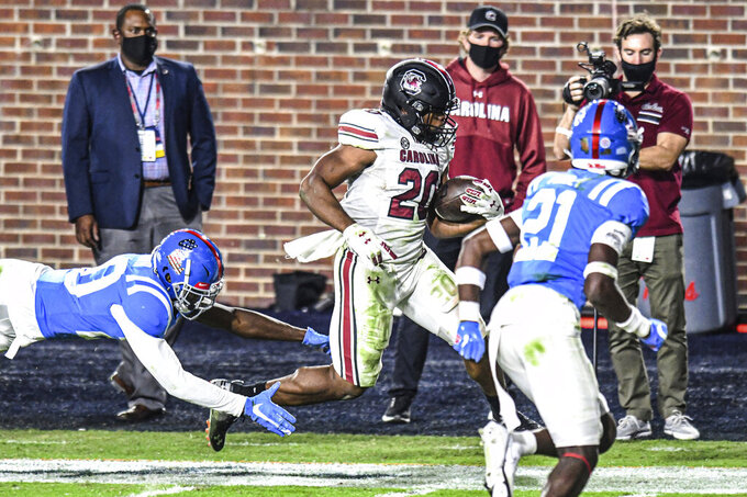 South Carolina running back Kevin Harris (20) scores past a diving Mississippi defensive back Keidron Smith (20) during the second half of an NCAA college football game in Oxford, Miss., Saturday, Nov. 14, 2020. (AP Photo/Bruce Newman)