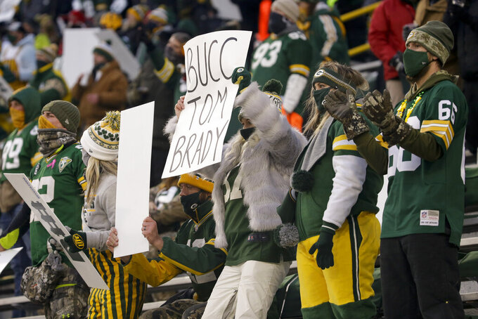 Packers fans cheer during the second half of the NFC championship NFL football game between the Tampa Bay Buccaneers and Green Bay Packers in Green Bay, Wis., Sunday, Jan. 24, 2021. (AP Photo/Mike Roemer)