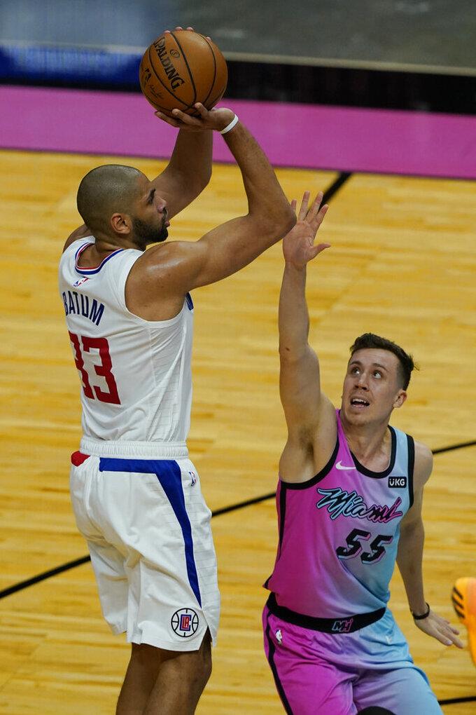 LA Clippers forward Nicolas Batum (33) aims a shot to the basket as Miami Heat guard Duncan Robinson (55) defends during the first half of an NBA basketball game, Thursday, Jan. 28, 2021, in Miami. (AP Photo/Marta Lavandier)