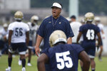 FILE - In this Aug. 2, 2019, file photo, Navy head coach Ken Niumatalolo gives direction to the team during NCAA college football training camp in Annapolis, Md. Niumatalolo decided to make some drastic changes after last year's disappointing season. (AP Photo/Tommy Gilligan, File)