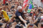 In this Saturday, Nov. 9, 2019 photo, former Brazilian President Luiz Inacio Lula da Silva is carried by supporters during a rally at the Metal Workers Union headquarters, in Sao Bernardo do Campo, Brazil. Da Silva addressed thousands of jubilant supporters a day after being released from prison.