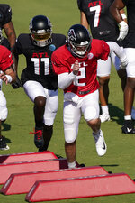 Atlanta Falcons quarterback Matt Ryan (2) and receiver Julio Jones (11) run drills during an NFL football practice Tuesday, Aug. 18, 2020, in Flowery Branch, Ga. (AP Photo/John Bazemore, Pool)