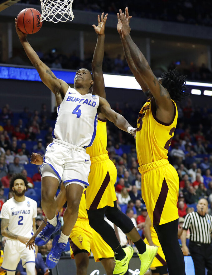 Buffalo's Davonta Jordan (4) heads to the basket past Arizona State's Romello White, right, during the first half of a first round men's college basketball game in the NCAA Tournament Friday, March 22, 2019, in Tulsa, Okla. (AP Photo/Jeff Roberson)