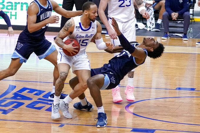 Seton Hall guard Takal Molson (15) fouls Villanova forward Brandon Slater (3) during the first half of an NCAA college basketball game, Saturday, Jan. 30, 2021, in Newark, N.J. (AP Photo/Mary Altaffer)