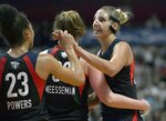 Washington Mystics' Elena Delle Donne, right, celebrates with Aerial Powers, left, and Meesseman as time winds down during the second half in Game 3 of basketball's WNBA Finals against the Connecticut Sun, Sunday, Oct. 6, 2019, in Uncasville, Conn. (AP Photo/Jessica Hill)