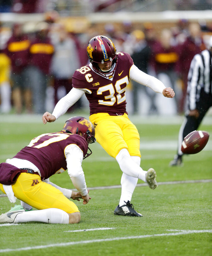 Minnesota kicker Emmit Carpenter (38) kicks a field goal with a hold by Minnesota punter Jacob Herbers (47) in the first quarter against Purdue in a NCAA college football game Saturday, Nov. 10, 2018, in Minneapolis. (AP Photo/Andy Clayton-King)
