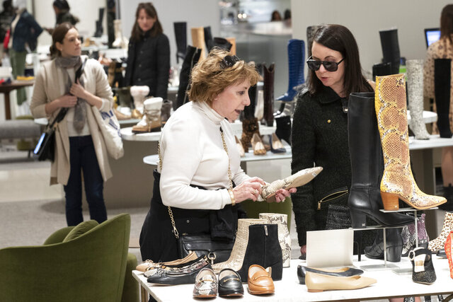 In this Tuesday, Nov. 26, 2019, photo shows customers shopping in the shoe department at the Nordstrom NYC Flagship in New York.