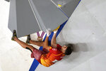 Alberto Gines Lopez, of Spain, competes during the bouldering portion of the men's sport climbing final at the 2020 Summer Olympics, Thursday, Aug. 5, 2021, in Tokyo, Japan. (AP Photo/Jeff Roberson)