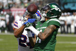 Buffalo Bills' Taron Johnson (24) deflects a pass to New York Jets' Robby Anderson (11) in the end zone during the first half of an NFL football game Sunday, Sept. 8, 2019, in East Rutherford, N.J. (AP Photo/Seth Wenig)