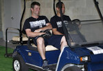 New York Yankees relief pitcher Adam Warren, left, rides in a golf cart at baseball spring training, Tuesday, Feb. 13, 2018, in Tampa, Fla. (AP Photo/Lynne Sladky)