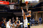 Marquette's Theo John, right, goes up for a shot against Villanova's Eric Dixon during the second half of an NCAA college basketball game, Wednesday, Feb. 10, 2021, in Villanova, Pa. (AP Photo/Matt Slocum)