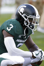 Michigan State running back LJ Scott pauses before an NCAA college football game against Utah State, Friday, Aug. 31, 2018, in East Lansing, Mich. (AP Photo/Al Goldis)