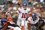 New York Giants quarterback Eli Manning (10) calls out at the line of scrimmage during the first half of the team's NFL preseason football game against the Cincinnati Bengals, Thursday, Aug. 22, 2019, in Cincinnati. (AP Photo/Frank Victores)
