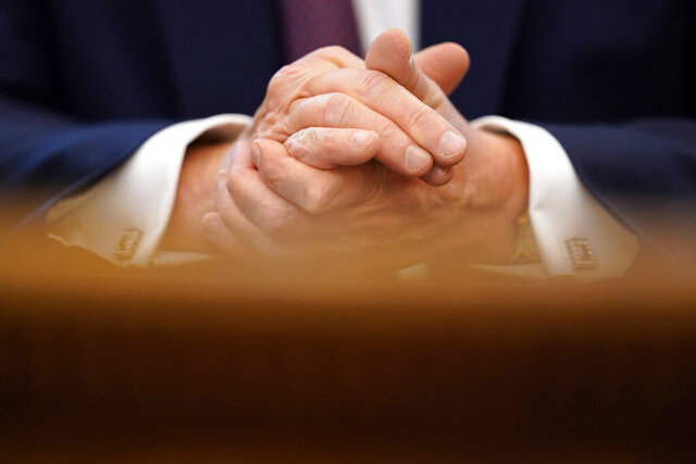 """FILE - In this Sept. 11, 2020, file photo President Donald Trump clasps his hands as he speaks in the Oval Office of the White House in Washington. Trump acknowledged that from early on he was intentionally """"playing down"""" the threat from the coronavirus outbreak that has gone on to kill more than 190,000 Americans. (AP Photo/Andrew Harnik, File)"""