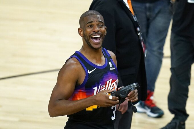 Phoenix Suns guard Chris Paul smiles at the crowd after Game 1 of basketball's NBA Finals against the Milwaukee Bucks, Tuesday, July 6, 2021, in Phoenix. The Suns defeated the Bucks 118-105. (AP Photo/Ross D. Franklin)