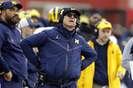 Michigan head coach Jim Harbaugh watches a replay during the first half of an NCAA college football game against Indiana, Saturday, Nov. 23, 2019, in Bloomington, Ind. (AP Photo/Darron Cummings)