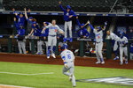 The Los Angeles Dodgers celebrate a three-run home run by Will Smith against the Atlanta Braves during the sixth inning in Game 5 of a baseball National League Championship Series Friday, Oct. 16, 2020, in Arlington, Texas.(AP Photo/Tony Gutierrez)